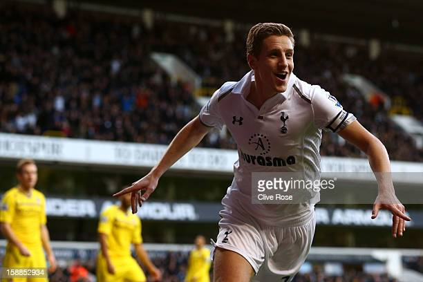 Michael Dawson of Tottenham Hotspur celebrates scoring their first goal during the Barclays Premier League match between Tottenham Hotspur and...