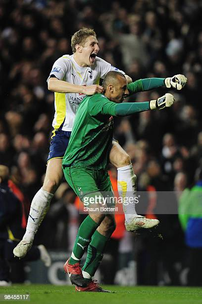 Michael Dawson of Tottenham Hotspur celebrates with goalkeeper Heurelho Gomes after the Barclays Premier League match between Tottenham Hotspur and...
