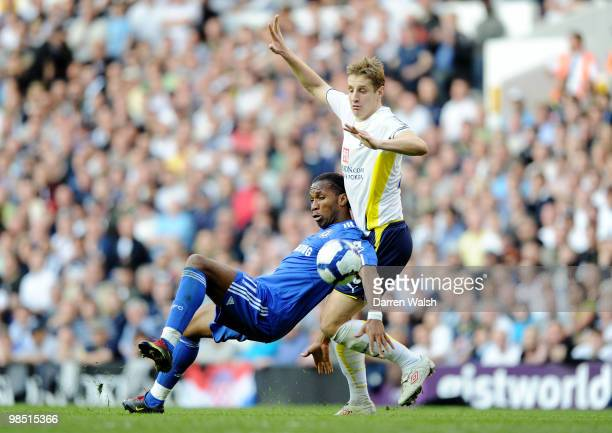 Michael Dawson of Tottenham Hotspur challenges Didier Drogba of Chelsea during the Barclays Premier League match between Tottenham Hotspur and...