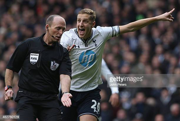 Michael Dawson of Tottenham Hotspur complains to referee Mike Dean during the Barclays Premier League match between Manchester United and Tottenham...
