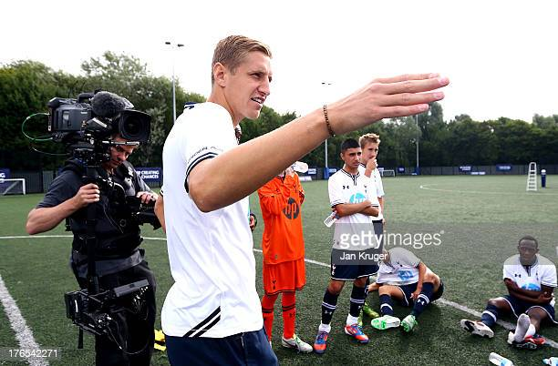 Michael Dawson of Tottenham Hotspur gives a halftime team talk to the Tottenham Hotspur U18 players during the Official Premier League Season Launch...