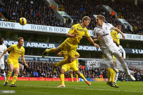 Michael Dawson of Tottenham Hotspur heads in their first goal during the Barclays Premier League match between Tottenham Hotspur and Reading at White...