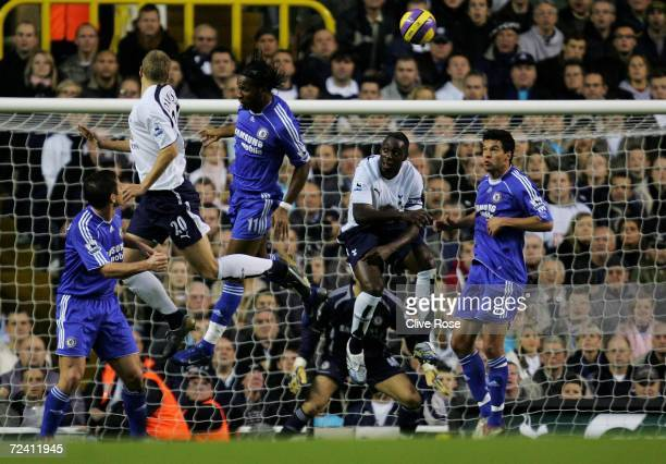 Michael Dawson of Tottenham rises above the Chelsea defence to score his teams first goal of the game during the Barclays Premiership match between...