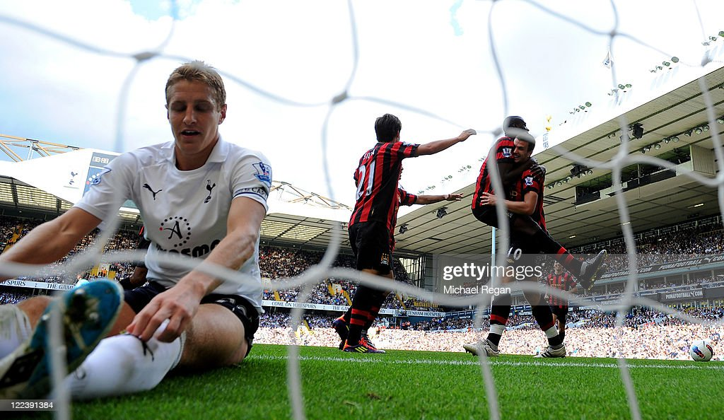 <a gi-track='captionPersonalityLinkClicked' href=/galleries/search?phrase=Michael+Dawson+-+Soccer+Player&family=editorial&specificpeople=453217 ng-click='$event.stopPropagation()'>Michael Dawson</a> of Tottenham sits in the goal dejected as <a gi-track='captionPersonalityLinkClicked' href=/galleries/search?phrase=Edin+Dzeko&family=editorial&specificpeople=4404455 ng-click='$event.stopPropagation()'>Edin Dzeko</a> of Manchester City scores his third goal during the Barclays Premier League match between Tottenham Hotspur and Manchester City at White Hart Lane on August 28, 2011 in London, England.
