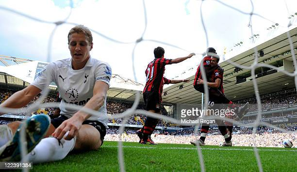 Michael Dawson of Tottenham sits in the goal dejected as Edin Dzeko of Manchester City scores his third goal during the Barclays Premier League match...