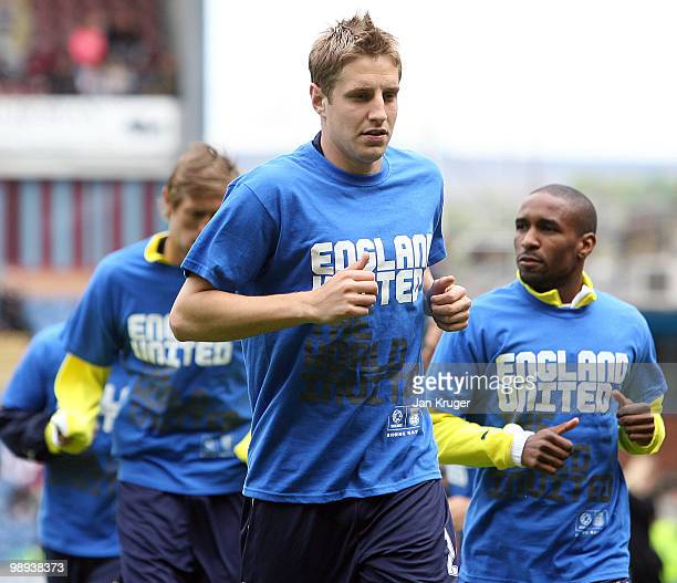 Michael Dawson of Tottenham warms up in a tshirt supporting the England bid for 2018 during the Barclays Premier League match between Burnley and...