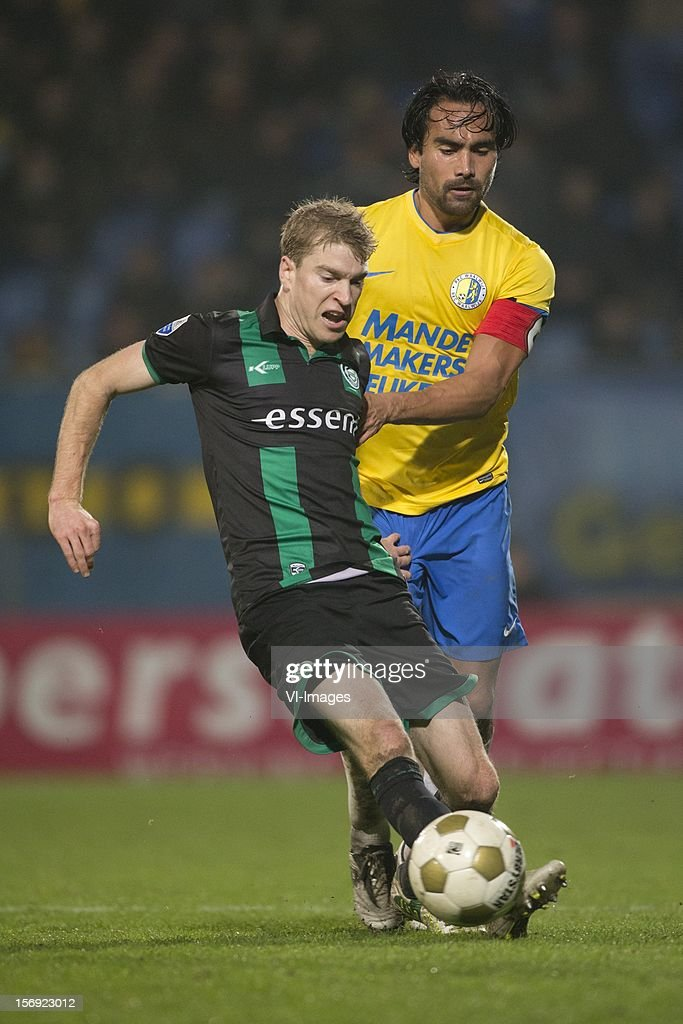 Michael de Leeuw of FC Groningen, Ard van Peppen of RKC Waalwijk during the Dutch Eredivisie match between RKC Waalwijk and FC Groningen at the Mandemakers Stadium on November 24, 2012 in Waalwijk, The Netherlands.