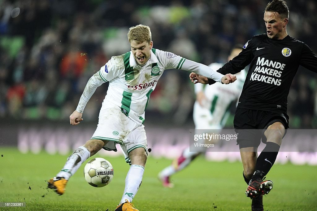 Michael de Leeuw of FC Groningen, Frank van Mosselveld of RKC Waalwijk, during the Dutch Eredivisie match between FC Groningen and RKC Waalwijk at the Euroborg on february 9, 2013 in Groningen, The Netherlands