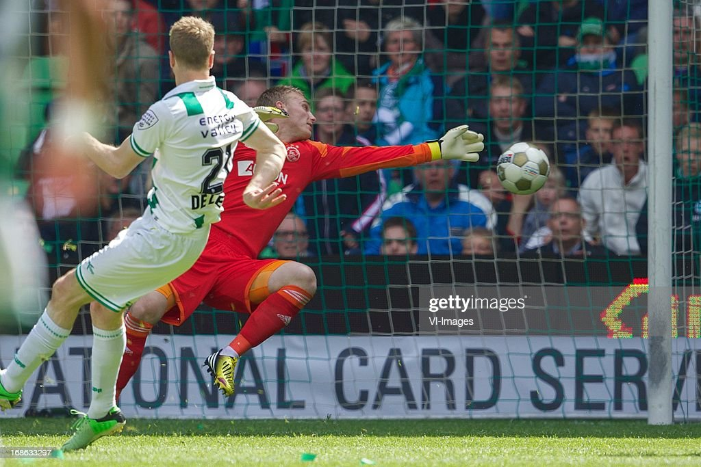 Michael de Leeuw of FC Groningen, goalkeeper Jasper Cillessen of Ajax during the Dutch Eredivisie match between FC Groningen and Ajax on May 12, 2013 at the Euroborg stadium in Groningen, The Netherlands.