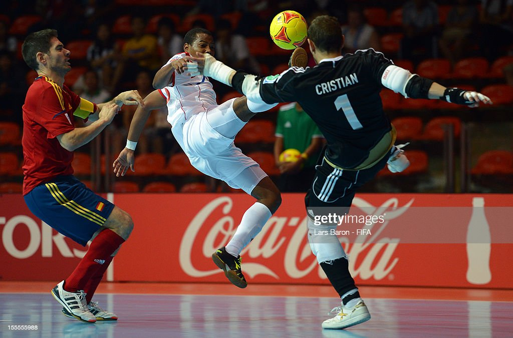 Michael de Leon of Panama scores his teams first goal against Kike and goalkeeper Cristian of Spain during the FIFA Futsal World Cup Group B match...