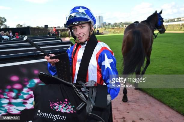 Michael Dee after riding Guangzhou to win Race 4 Winx Hall of Fame Trophy during Melbourne Racing at Flemington Racecourse on May 20 2017 in...