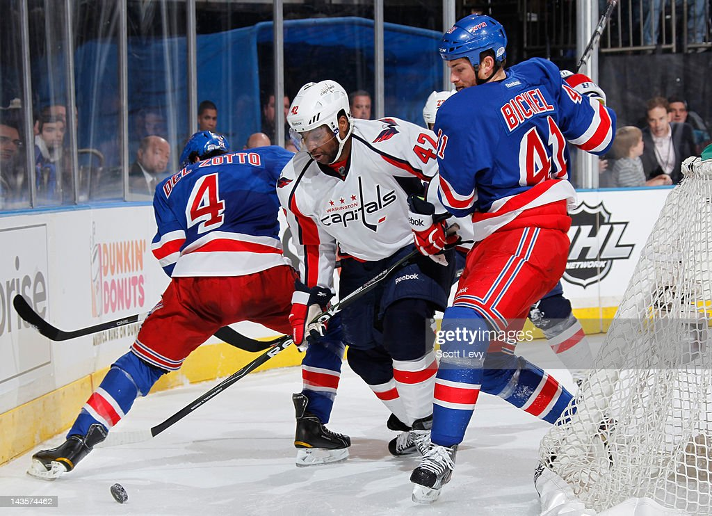 Michael Del Zotto #4 and Stu Bickel #41 of the New York Rangers skate against Joel Ward #42 of the Washington Capitals in Game One of the Eastern Conference Semifinals during the 2012 NHL Stanley Cup Playoffs at Madison Square Garden on April 28, 2012 in New York City.