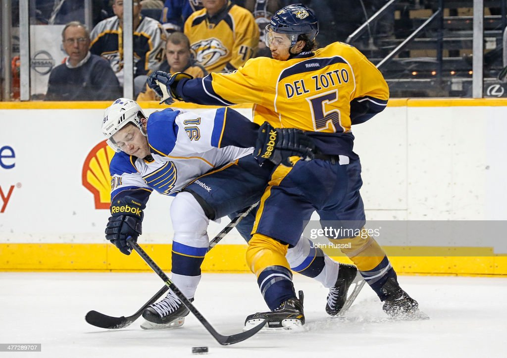 <a gi-track='captionPersonalityLinkClicked' href=/galleries/search?phrase=Michael+Del+Zotto&family=editorial&specificpeople=4044191 ng-click='$event.stopPropagation()'>Michael Del Zotto</a> #5 of the Nashville Predators battles against <a gi-track='captionPersonalityLinkClicked' href=/galleries/search?phrase=Vladimir+Tarasenko&family=editorial&specificpeople=6142635 ng-click='$event.stopPropagation()'>Vladimir Tarasenko</a> #91 of the St. Louis Blues at Bridgestone Arena on March 6, 2014 in Nashville, Tennessee.