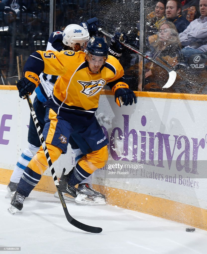 <a gi-track='captionPersonalityLinkClicked' href=/galleries/search?phrase=Michael+Del+Zotto&family=editorial&specificpeople=4044191 ng-click='$event.stopPropagation()'>Michael Del Zotto</a> #5 of the Nashville Predators checks <a gi-track='captionPersonalityLinkClicked' href=/galleries/search?phrase=Bryan+Little&family=editorial&specificpeople=540533 ng-click='$event.stopPropagation()'>Bryan Little</a> #18 of the Winnipeg Jets at Bridgestone Arena on March 1, 2014 in Nashville, Tennessee.