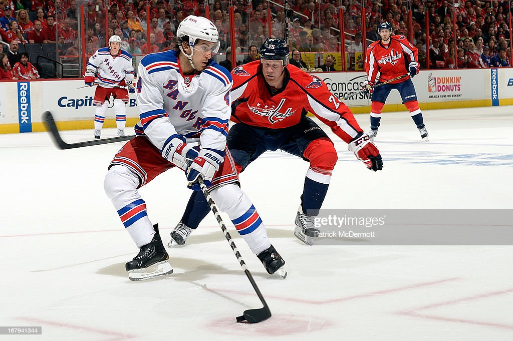 <a gi-track='captionPersonalityLinkClicked' href=/galleries/search?phrase=Michael+Del+Zotto&family=editorial&specificpeople=4044191 ng-click='$event.stopPropagation()'>Michael Del Zotto</a> #4 of the New York Rangers battles for the puck against <a gi-track='captionPersonalityLinkClicked' href=/galleries/search?phrase=Jason+Chimera&family=editorial&specificpeople=211264 ng-click='$event.stopPropagation()'>Jason Chimera</a> #25 of the Washington Capitals in Game One of the Eastern Conference Quarterfinals during the 2013 NHL Stanley Cup Playoffs at Verizon Center on May 2, 2013 in Washington, DC.