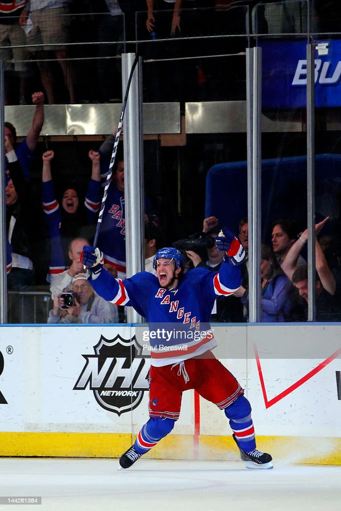 <a gi-track='captionPersonalityLinkClicked' href=/galleries/search?phrase=Michael+Del+Zotto&family=editorial&specificpeople=4044191 ng-click='$event.stopPropagation()'>Michael Del Zotto</a> #4 of the New York Rangers celebrates after he scored a goal in the third period against the Washington Capitals in Game Seven of the Eastern Conference Semifinals during the 2012 NHL Stanley Cup Playoffs at Madison Square Garden on May 12, 2012 in New York City.