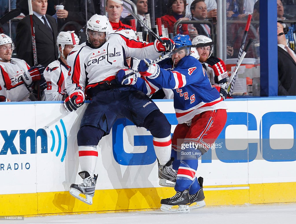 Michael Del Zotto #4 of the New York Rangers checks Joel Ward #42 of the Washington Capitals in Game Five of the Eastern Conference Semifinals during the 2012 NHL Stanley Cup Playoffs at Madison Square Garden on May 7, 2012 in New York City.