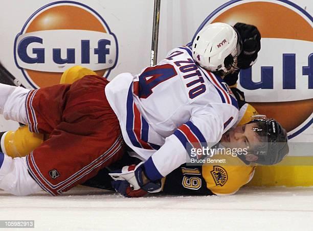 Michael Del Zotto of the New York Rangers checks Tyler Seguin of the Boston Bruins at the TD Garden on October 23 2010 in Boston Massachusetts The...