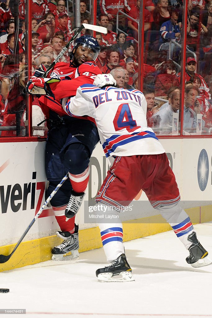 Michael Del Zotto #4 of the New York Rangers pushes Joel Ward #42 of the Washington Capitals against the boards Game Three of the Eastern Conference Semifinals of the 2012 NHL Stanley Cup Playoffs on May 2, 2012 at the Verizon Center in Washington, DC. The Rangers won 3-2 in 3 overtimes.