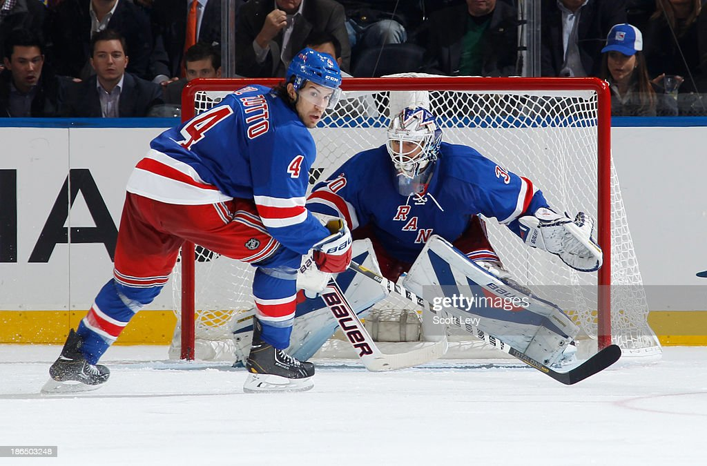 <a gi-track='captionPersonalityLinkClicked' href=/galleries/search?phrase=Michael+Del+Zotto&family=editorial&specificpeople=4044191 ng-click='$event.stopPropagation()'>Michael Del Zotto</a> #4 of the New York Rangers skates in front of <a gi-track='captionPersonalityLinkClicked' href=/galleries/search?phrase=Henrik+Lundqvist&family=editorial&specificpeople=217958 ng-click='$event.stopPropagation()'>Henrik Lundqvist</a> #30 during a game against the Buffalo Sabres at Madison Square Garden on October 31, 2013 in New York City.