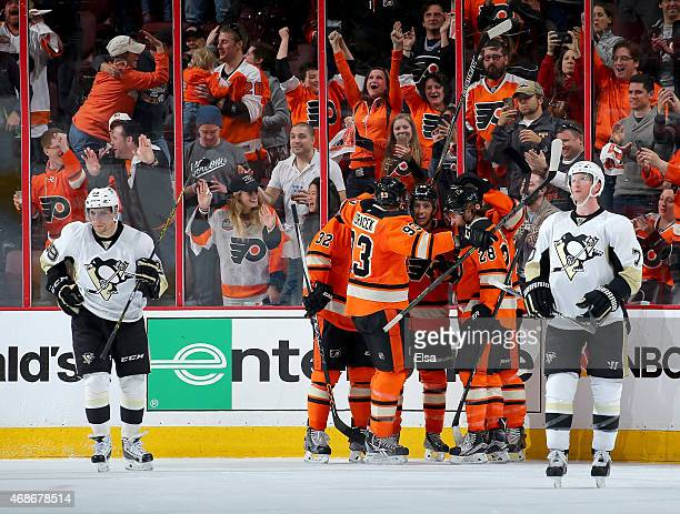 Michael Del Zotto of the Philadelphia Flyers is congratulated by teammates after the scored in the third period as Paul Martin and David Perron of...