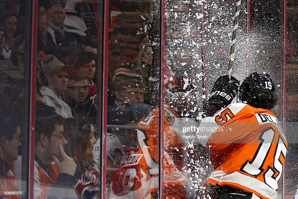 Michael Del Zotto #15 of the Philadelphia Flyers misses a check and crashes into the boards against the Montreal Canadiens during the third period at Wells Fargo Center on February 2, 2016 in Philadelphia, Pennsylvania.