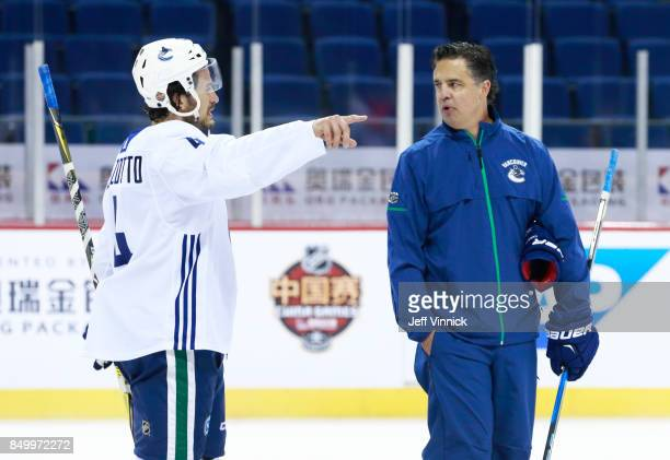 Michael Del Zotto of the Vancouver Canucks talks to head coach Travis Green during their practice at MercedesBenz Arena September 20 2017 in Shanghai...