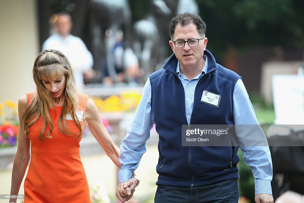 Michael Dell chairman and chief executive officer of Dell Inc and his wife Susan attend the Allen Company Sun Valley Conference on July 10 2015 in...