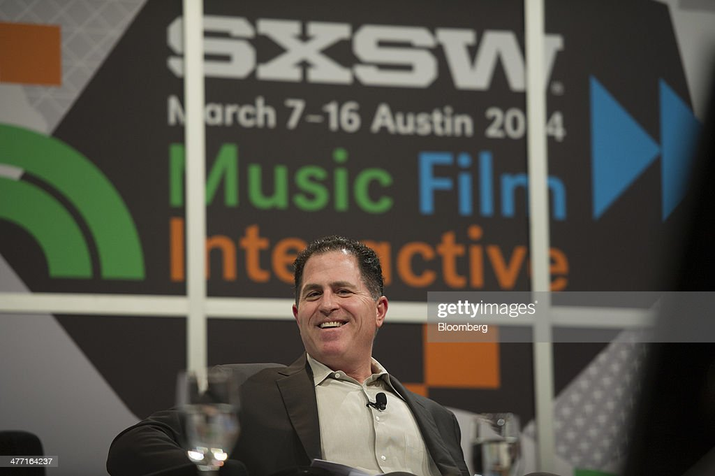 Michael Dell, chairman and chief executive officer of Dell Inc., speaks during a panel discussion at the South By Southwest (SXSW) Interactive Festival in Austin, Texas, U.S., on Friday, March 7, 2014. The SXSW conferences and festivals converge original music, independent films, and emerging technologies while fostering creative and professional growth. Photographer: David Paul Morris/Bloomberg via Getty Images