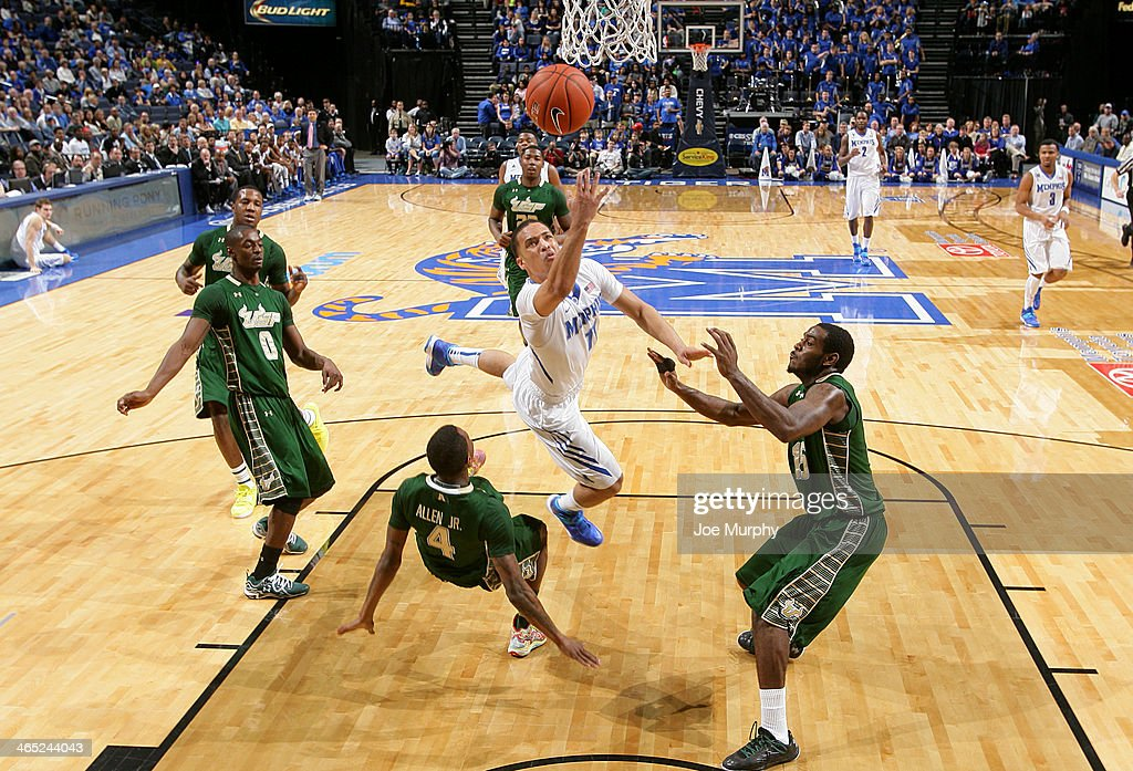 Michael Dixon Jr. #11 of the Memphis Tigers drives to the basket for a layup against Corey Allen Jr. #4 of the USF Bulls on January 26, 2014 at FedExForum in Memphis, Tennessee. Memphis beat South Florida 80-58.