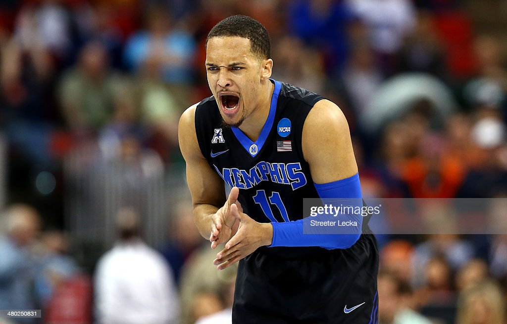 Michael Dixon Jr #11 of the Memphis Tigers reacts after a play in the first half against the Virginia Cavaliers during the third round of the 2014...