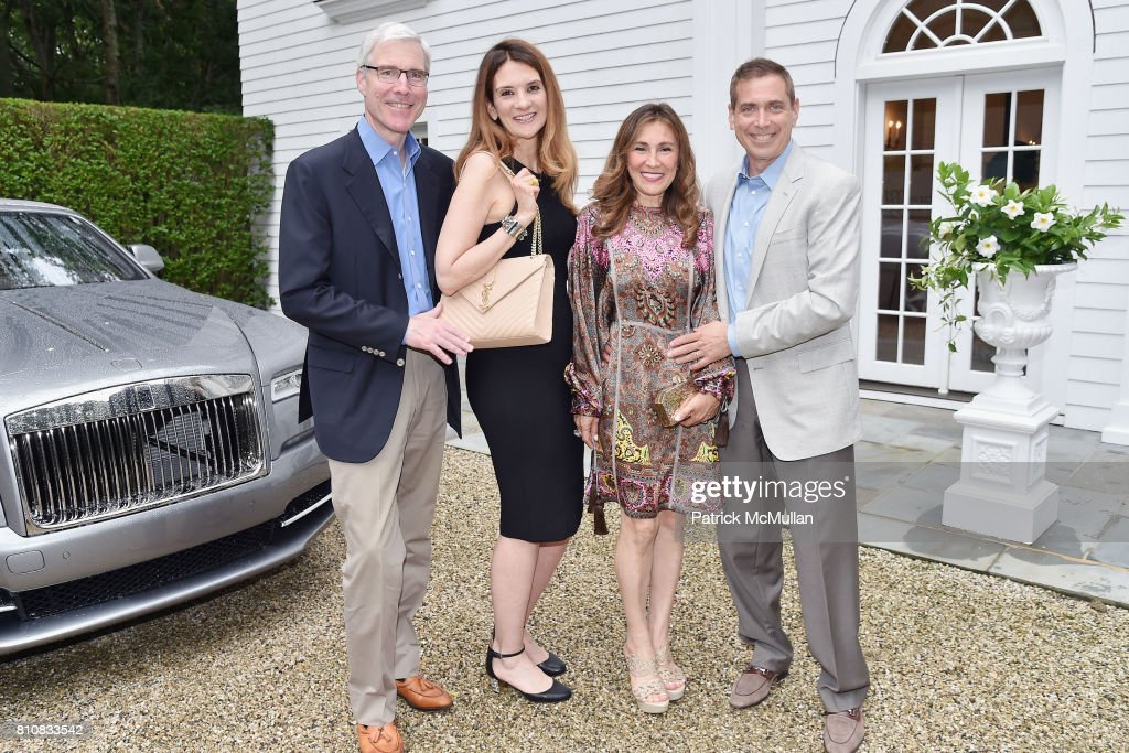 Michael Dougherty, Laurie Sanderson, Maria Fishel and Kenneth Fishel attend Katrina and Don Peebles Host NY Mission Society Summer Cocktails at Private Residence on July 7, 2017 in Bridgehampton, New York.