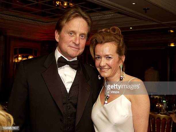 Michael Douglas and Caroline GruosiScheufele during Cannes 2002 'Femme Fatale' Dinner at Le Dome Carlton Hotel in Cannes France