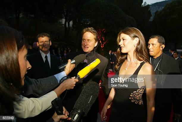 Michael Douglas and Catherine Zeta Jones arrive at the Laureus Sport for Good Foundation Dinner at the Salles des Etoiles in the Sporting Club in...