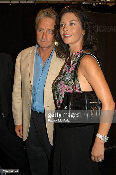 Michael Douglas and Catherine Zeta Jones attend Michael Kors Spring 2006 Collection at The Tent at Bryant Park on September 13 2005 in New York City