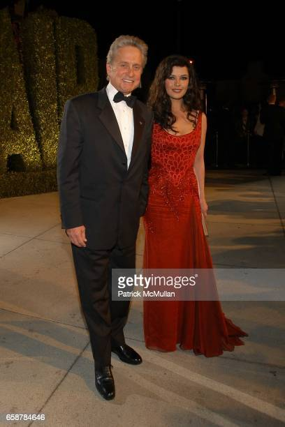 Michael Douglas and Catherine Zeta Jones attend the 2004 Vanity Fair Oscar Party at Mortons on February 29 2004 in Beverly Hills California