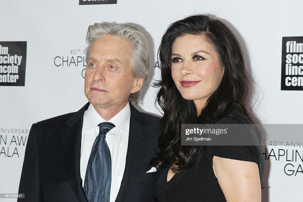 Michael Douglas (L) and Catherine Zeta Jones attend the 40th Anniversary Chaplin Award Gala at Avery Fisher Hall at Lincoln Center for the Performing Arts on April 22, 2013 in New York City.