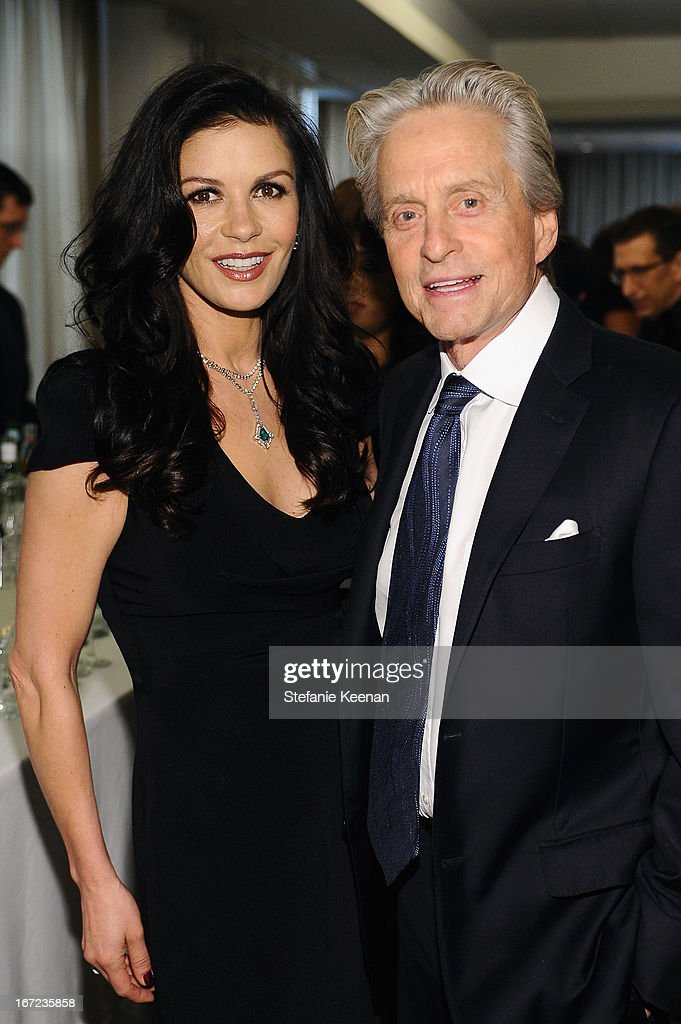 Michael Douglas (R) and Catherine Zeta Jones attend the Grey Goose cocktail reception of The Film Society of Lincoln Center's 40th Chaplin Award Gala at Avery Fisher Hall, Lincoln Center on April 22, 2013 in New York City.
