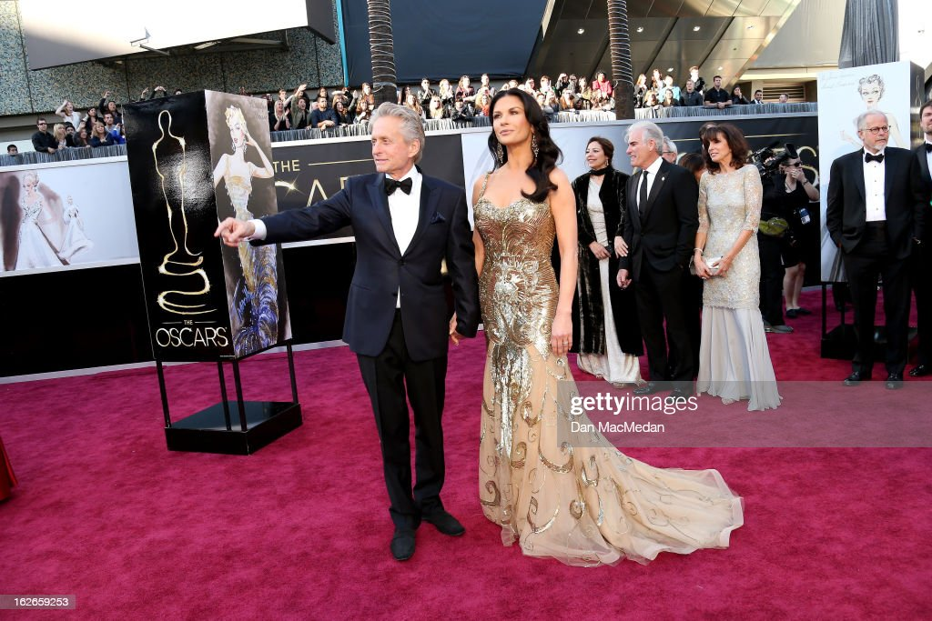 Michael Douglas and Catherine Zeta-Jones arrive at the 85th Annual Academy Awards at Hollywood & Highland Center on February 24, 2013 in Hollywood, California.