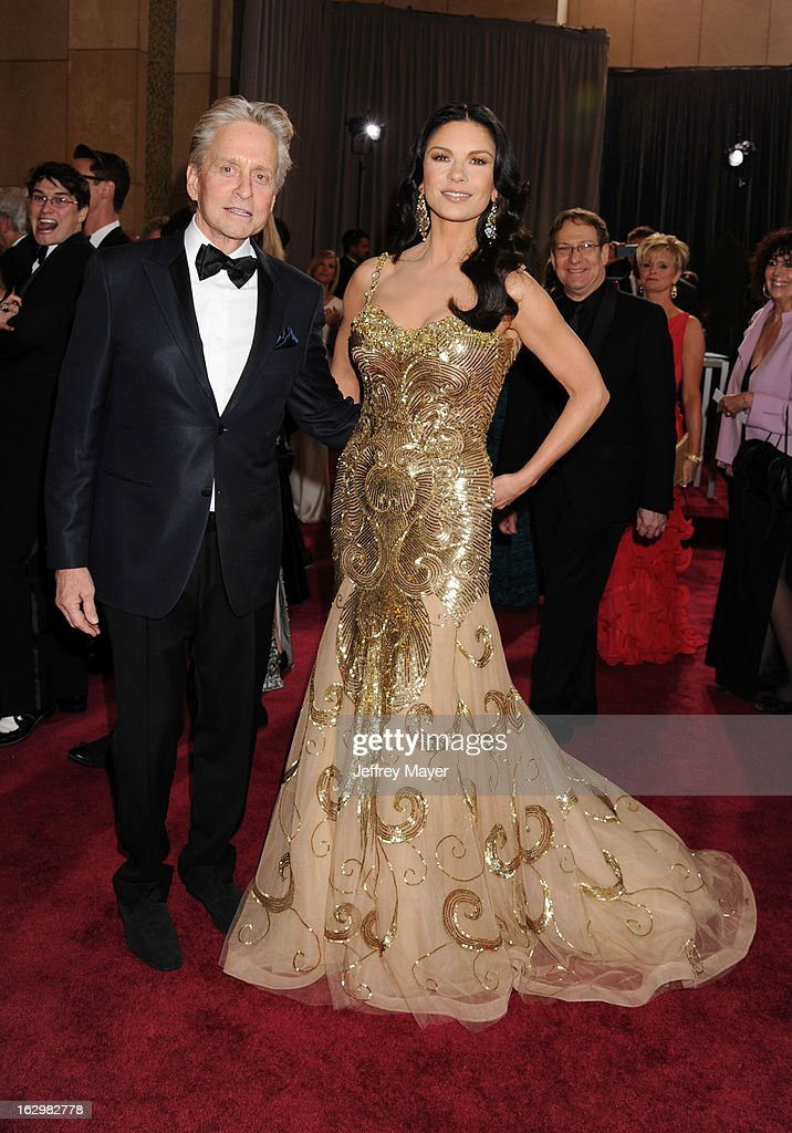Michael Douglas and Catherine Zeta-Jones arrive at the 85th Annual Academy Awards at Dolby Theatre on February 24, 2013 in Hollywood, California.