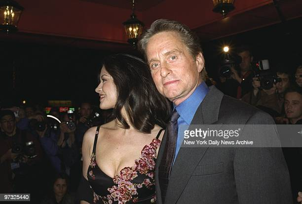 Michael Douglas and Catherine ZetaJones arrive at the Russian Tea Room for a rehearsal dinner on the eve of their wedding at the Plaza Hotel