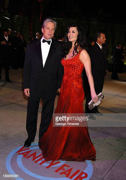 Michael Douglas and Catherine ZetaJones during 2004 Vanity Fair Oscar Party Arrivals at Mortons in Beverly Hills California United States
