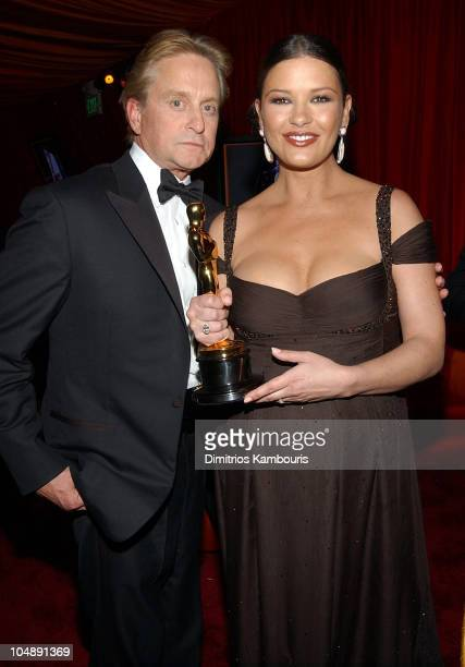 Michael Douglas and Catherine ZetaJones during Elton John AIDS Foundation's 11th Annual Oscar party cohosted by In Style and AOL in association with...