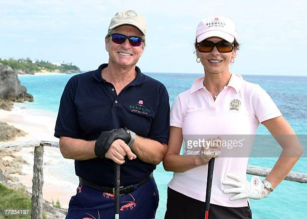 Michael Douglas and Catherine ZetaJones pose on the fourth tee during the proam prior to the start of PGA Grand Slam at the Mid Ocean Club on October...