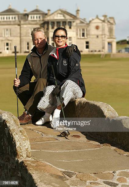 Michael Douglas and Catherine ZetaJones sit on the Swilken bridge on the eighteenth hole of the Old Course during practice day of the 2005 Dunhill...