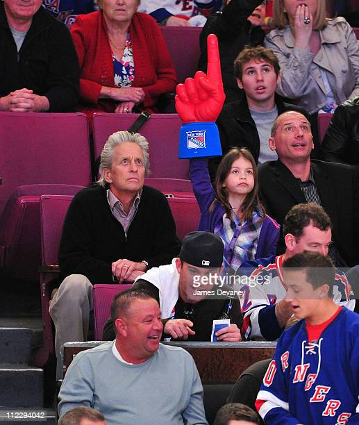 Michael Douglas and daughter Carys Zeta Douglas attend the Washington Capitals vs New York Rangers game at Madison Square Garden on April 17 2011 in...