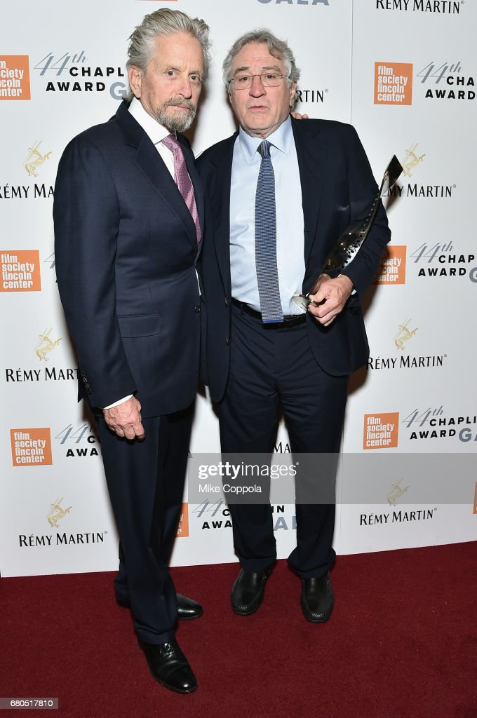 Michael Douglas (L) and Robert De Niro backstage during the 44th Chaplin Award Gala at David H. Koch Theater at Lincoln Center on May 8, 2017 in New York City.