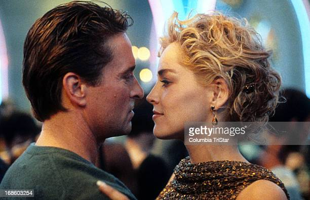 Michael Douglas and Sharon Stone dancing in scene from the film 'Basic Instinct' 1992