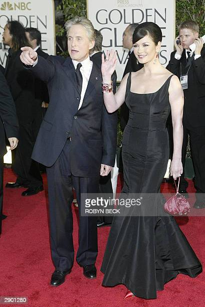 Michael Douglas and wife Catherine ZetaJones arrive for the 61st Golden Globe awards in Beverly Hills California 25 January 2004 AFP PHOTO / Robyn...