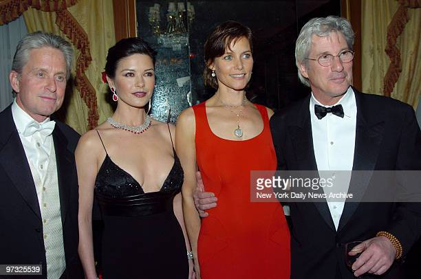 Michael Douglas and wife Catherine ZetaJones who is the honorary chairwoman join Honorees Carey Lowell and husband Richard Gere at the Eighth Red...